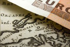 Euro banknote and a map of Europe. Close-up of a 50-euro banknote and an old map of Europe stock photos