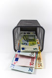 Euro banknote in metal basket Royalty Free Stock Images