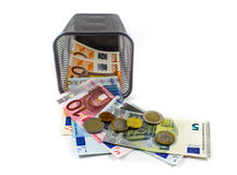 Euro banknote in metal basket. White background Royalty Free Stock Photography