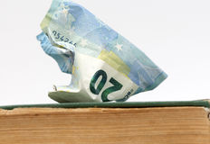 Euro banknote od an old weathered book. education cost Stock Photos