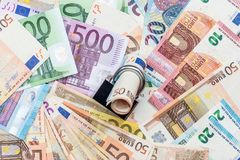 Euro banknote and padlock. Money security concept - euro banknote and padlock Stock Image