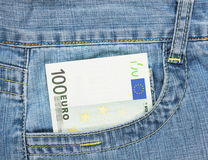Euro banknote in pocket. One hundred euro banknote in jeans pocket Stock Photos