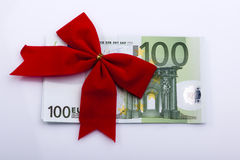 Euro banknote with red ribbon. Red ribbon on one hundred Euro banknote, isolated on white Stock Image