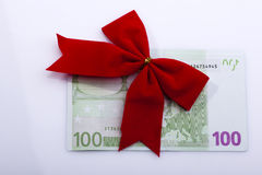 Euro banknote with red ribbon. Red ribon on one hundred Euro banknote, isolated on white Royalty Free Stock Photos