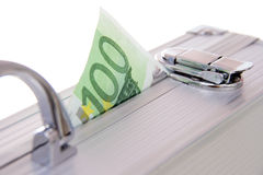 Euro banknote sticking out of suitcase. One hundred euro banknote sticking out of an aluminum suitcase isolated on white Royalty Free Stock Photography