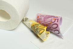 Euro banknote and toilet paper Stock Image