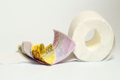 Euro banknote and toilet paper Royalty Free Stock Photos