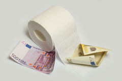 Euro banknote and toilet paper Stock Photos
