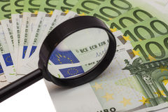 Euro banknote under magnifying glass Stock Images
