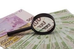 Euro banknote under magnifying glass Stock Photography