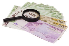 Euro banknote under magnifying glass Royalty Free Stock Images