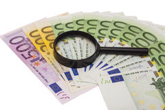Euro banknote under magnifying glass Royalty Free Stock Photos