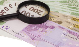 Euro banknote under magnifying glass Stock Photo