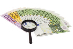 Euro banknote under magnifying glass Stock Photos