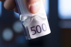 Euro banknote with white bow Royalty Free Stock Photos