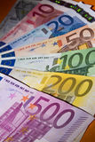 Euro banknotes. A number of Euro banknotes on a shelf Stock Photography