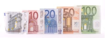 Euro Banknotes. Panoramic image of Euro banknotes from five to one hundred euros. Isolated on white Royalty Free Stock Photography