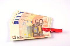 Euro banknotes. Some bracketed 50-euro banknotes on the table Stock Photography