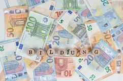 Euro banknotes with the address Education in foreground. Euro bills with different banknotes Stock Photo