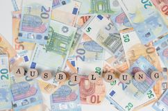 Euro banknotes with the address Education in foreground. Euro bills with different banknotes Royalty Free Stock Image