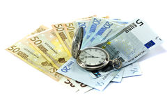 Euro banknotes and antique clock Stock Photography
