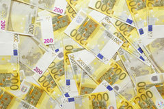 Euro banknotes background. Background of scattered and overlaying 200 euro bills or banknotes Royalty Free Stock Photo