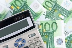 Euro banknotes background and calculator Royalty Free Stock Photo