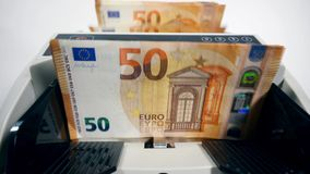Euro banknotes are being processed by the counting device. 4K stock video