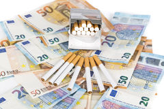 Euro banknotes bills with cigarettes Royalty Free Stock Photos