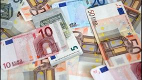 Euro banknotes are blown away Stock Photos