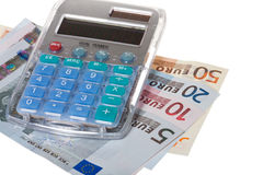 Euro banknotes and calculator Stock Images