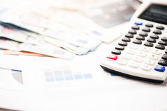 Euro banknotes with calculator and charts Royalty Free Stock Photography