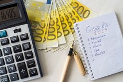Euro banknotes with calculator and notepad with goals stock photos