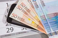 Euro banknotes calendar phone Royalty Free Stock Photos