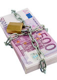 Euro banknotes with chain and padlock Stock Images