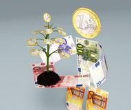 Euro banknotes character brings one euro tree. A character made of euro banknotes brings in its hands a small one euro tree planted on little soil Stock Photo
