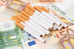 Euro banknotes with cigarettes Stock Photos