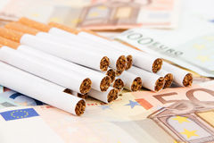 Euro banknotes with cigarettes Royalty Free Stock Image