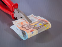 Euro banknotes clamped in flat-nose pliers Royalty Free Stock Photos