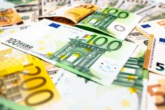 Euro banknotes close up. Several hundred. Euro vs dollar as background royalty free stock photo