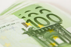 Euro banknotes. Close-up view on a detail of 100 euro banknotes Royalty Free Stock Image