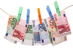 Euro banknotes on clothesline Stock Image