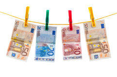 Euro banknotes on clothesline Stock Photos