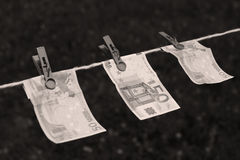 Euro banknotes with clothespins Stock Images