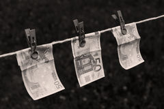 Euro banknotes with clothespins Royalty Free Stock Images