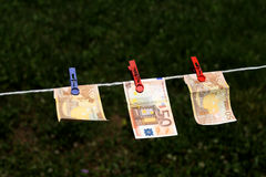 Euro banknotes with clothespins Royalty Free Stock Photo