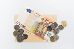 Euro banknotes and coin. On white background Royalty Free Stock Photography