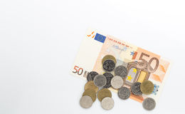 Euro banknotes and coin. On white background royalty free stock image