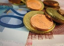Euro banknotes and coins. Close up of euro banknotes and coins Royalty Free Stock Photo
