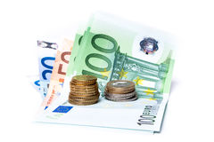 Euro banknotes and coins. Euro banknotes with various coins Stock Image